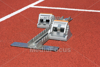 Athletics Starting Blocks On Race Track Stock Photo