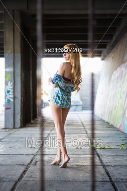 Attractive Barefoot Woman Posing In Shirt Outdoors Stock Photo