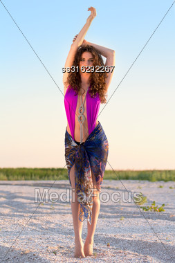 Attractive Curly Young Brunette Posing In Fashionable Beachwear Stock Photo