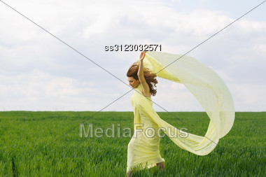 Attractive Girl Dancing In A Green Field Stock Photo