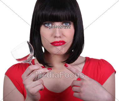 Attractive Woman Holding An Empty Glass Stock Photo