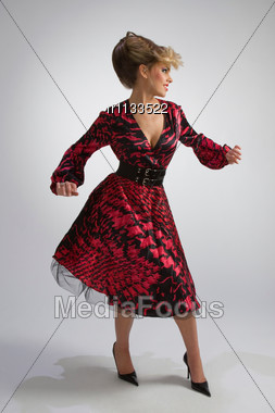 Attractive Woman In Spotted Dress Stock Photo