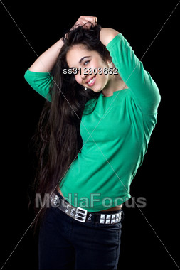 Attractive Woman Unbinding Her Long Hair. Stock Photo