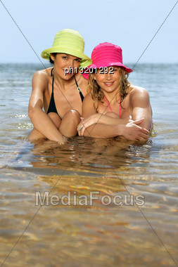 Attractive Women Swimming Stock Photo