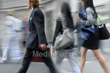 Attractive Women Walking On A City Street Motion Blur, Young Businessman Walking By Stock Photo