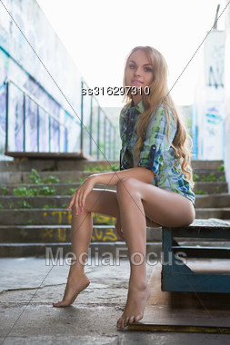 Attractive Young Blond Barefoot Woman Posing Outdoors Stock Photo
