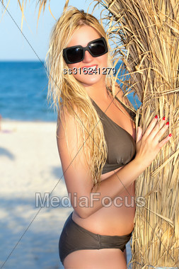 Attractive Young Blond Woman Wearing Black Sunglasses Stock Photo