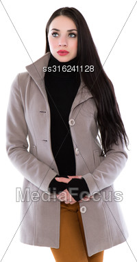 Attractive Young Brunette In Beige Coat And Black Jersey. Isolated On White Stock Photo