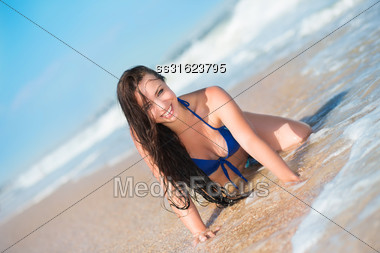 Attractive Young Brunette Posing Near The Sea Stock Photo