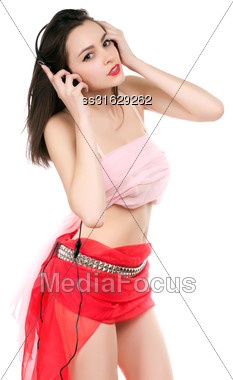 Attractive Young Lady Posing And Listening To Music. Isolated On White Stock Photo