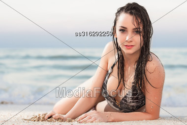 Attractive Young Woman In Wet Swimsuit Posing Near The Sea Stock Photo