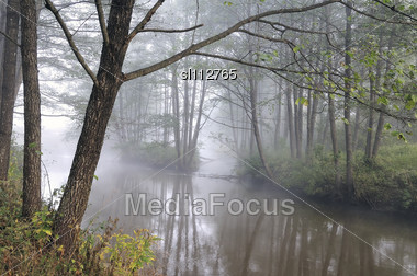 Autumn Fog Over The Wild River. Early Morning. Dz?kijos National Park In Lithuania Stock Photo