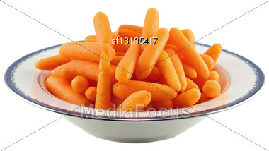 Baby Carrots On A White Background Stock Photo