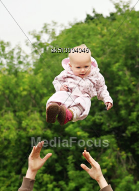 Baby Flying In The Sky Stock Photo