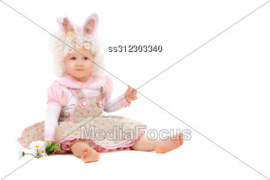 Baby Girl With Flowers In Hand Wearing A Dress. Stock Photo