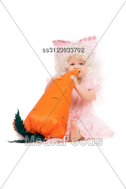 Baby Girl Plays With A Carrot. Stock Photo