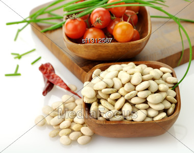 Baby Lima Beans , Tomatoes And Spices In Wooden Bowls Stock Photo