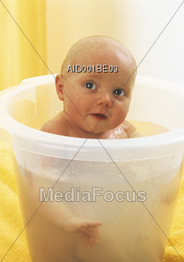 Stock Photo Baby Taking Bath In Bucket - Image AID001BE03 - Baby ...