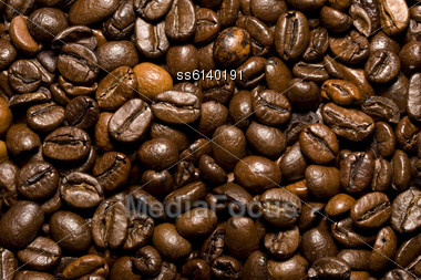 Background Of Brown Roasted Coffee Beans Close-up Stock Photo
