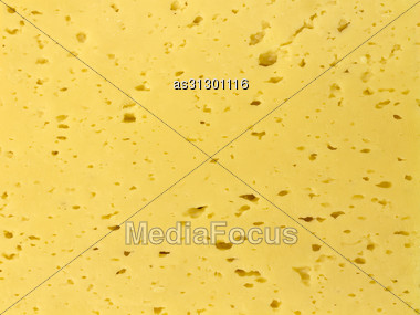 Background Of Fresh Yellow Swiss Cheese With Holes Stock Photo