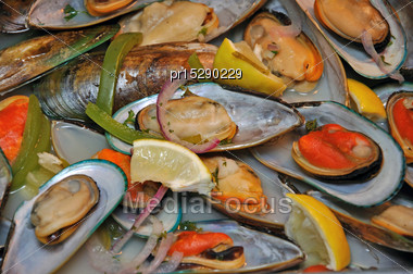 Background Of Green-lipped Mussels Ready To Serve Stock Photo