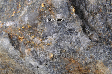 Background Of Natural Gold In A Piece Of Quartz From Australia Stock Photo