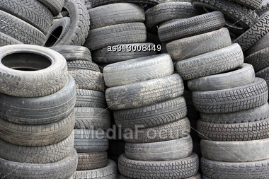 Background With Old Tires On Each Other Stock Photo