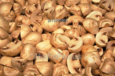 Background Of Sliced Mushrooms Ready For Cooking Stock Photo
