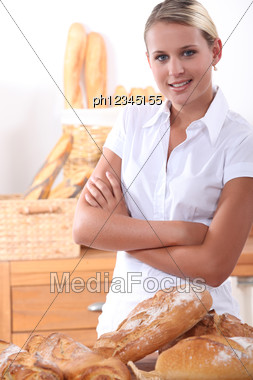 Baker Posing With Her Bread Stock Photo