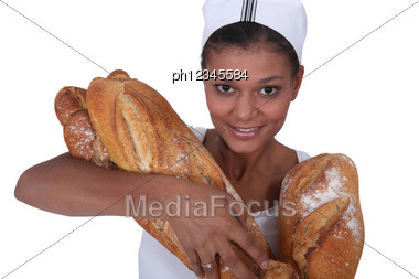 Bakery Worker With Bread Stock Photo