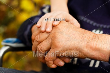 Balance Concept - Young Hand Holding The Old One Stock Photo