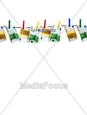 Banknotes Drying On A Rope After Laundry Stock Photo
