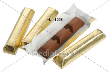 Bars Of Chocolate In Gold Foil, Isolated On A White Background Stock Photo