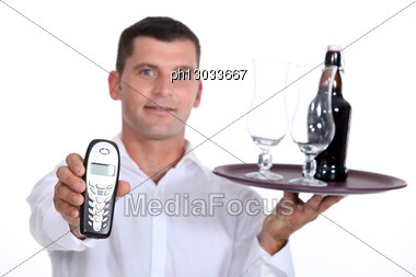 Bartender Holding A Tray Stock Photo