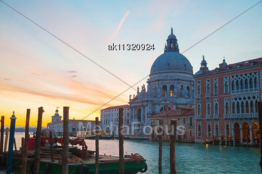 Basilica Di Santa Maria Della Salute With Vaporetto Floating At Grand Canal Stock Photo
