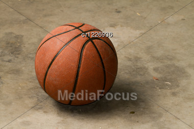 Basketball On A Cement Floor Stock Photo