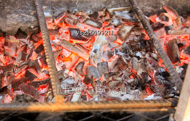BBQ With Hot Coals For Cooking Meat. Charcoal Fire Grill. Barbecue Embers Glowing In Red Fire Stock Photo