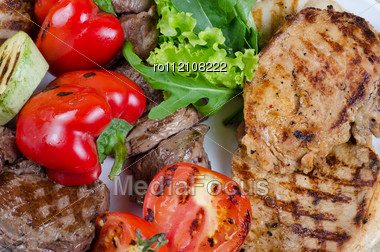 BBQ Meat With Vegetables And Greens Closeup Stock Photo