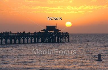 Beach Sunset - Naples Pier Stock Photo