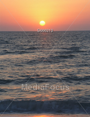 Beach Sunset with Rippling Waves Stock Photo