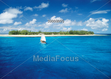 Beach and Water with Tropical Island, Seychelles Stock Photo