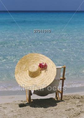 Beaches - Beach Chair and Hat Stock Photo