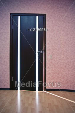 Beam Of Light From Ajar Wooden Door Stock Photo