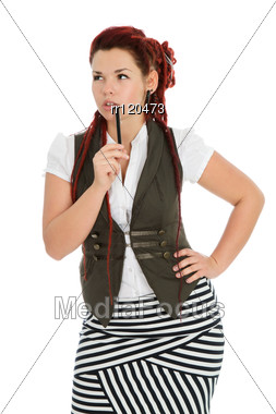 Beautiful Accountant With Pen Wearing Vest And Striped Skirt Stock Photo