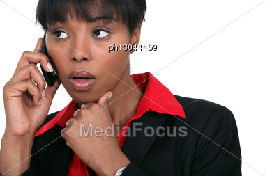 Beautiful Black Woman Making A Call Isolated On White Stock Photo