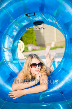 Beautiful Blond Woman Posing With Rubber Ring In Swimming Pool Stock Photo