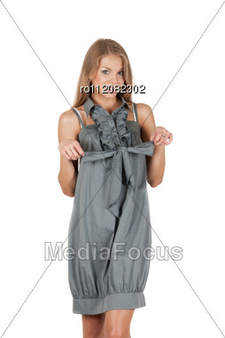 Beautiful Blonde Woman Wearing Grey Dress On A White Stock Photo