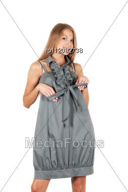 Beautiful Blonde Woman Wearing Grey Dress On A White Stock Photo