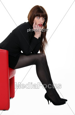 Beautiful Businesswoman Over The Phone Stock Photo