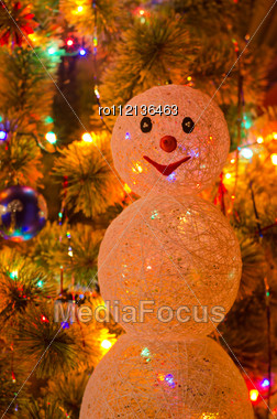 Beautiful Christmas Fur-tree Decorated With Snowman Toy Stock Photo